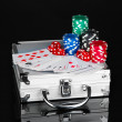 Poker set on metallic case isolated on black background — Stock Photo #11726619