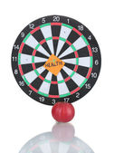 Darts with a sticker symbolizing health isolated on white — Stock Photo