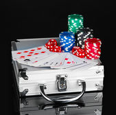 Poker set on a metallic case isolated on black background — Stock Photo