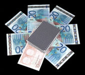 Euro and a deck of playing cards isolated on black — Stock Photo