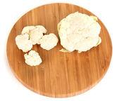 Fresh cauliflower on wooden board isolated on white — Stock Photo