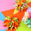 Colorfull origami kusudamas on bright paper background - Stock fotografie