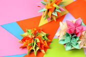 Colorfull origami kusudamas on bright paper background — Stock Photo