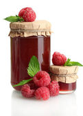 Jars with jam and ripe raspberries with mint isolated on white — Stock Photo