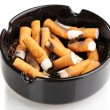 Cigarette butts in ashtray isolateed on white — Stock Photo