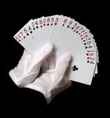Cards in hands isolated on black — Stock Photo