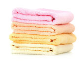 Colorful towels isolated on white — Stock Photo