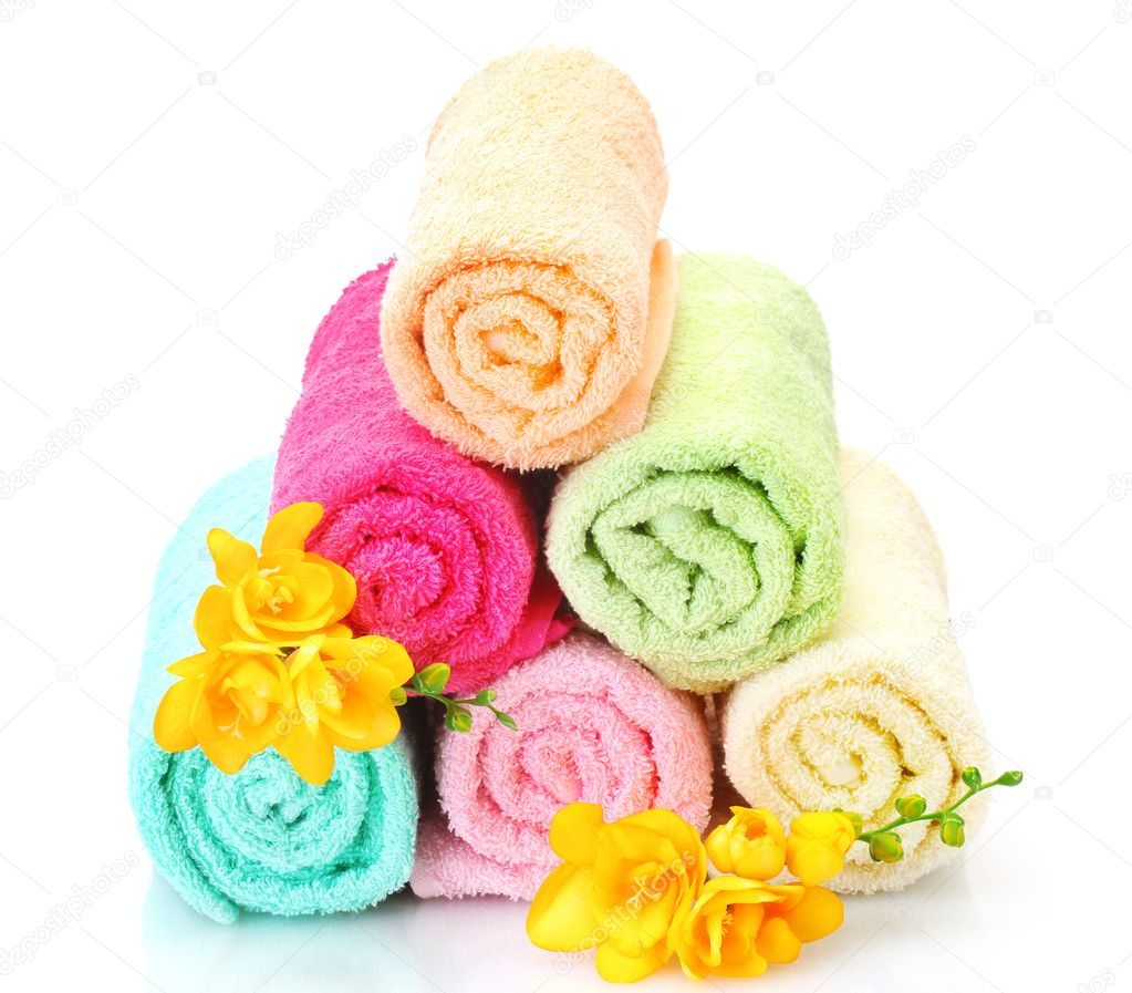 Colorful towels and flowers isolated on white — Stock Photo #11759525