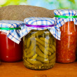 Jars with canned vegetables on green background close-up - Foto de Stock