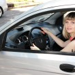 Happy smiling blonde woman in car — Stock Photo