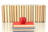 Pile of books with an apple on white background close-up — Stock Photo