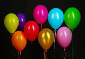 Colorful balloons isolated on black background — Photo