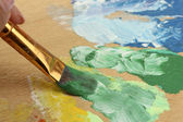 Abstract gouache paint and brush on wooden palette — Foto Stock