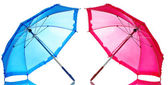 Blue and pink umbrellas isolated on white — Stock Photo