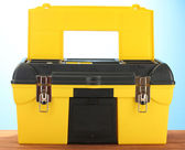 Open yellow tool box on blue background close-up — Stock Photo