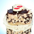 Sweet cake with chocolate  on blue background - Stockfoto