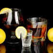 Variety of alcoholic drinks isolated on black — Stock Photo #11787644