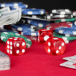 Stock Photo: Playing cards on a red poker table close-up