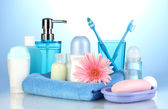 Bathroom setting on blue background — Stock Photo