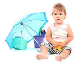 Cute baby with bucket and spade near umbrella isolated on white — Stock Photo