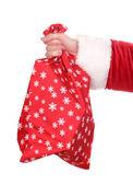 Noel Baba el çantası hediye üzerinde beyaz izole tutarak — Stok fotoğraf