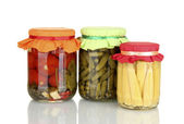 Jars with canned vegetables isolated on white — Stock Photo