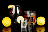 A variety of alcoholic drinks isolated on black — Stock Photo