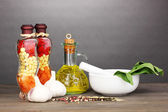 Set of ingredients and spice for cooking on wooden table on grey background — Stock Photo
