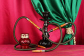 Hookah on a wooden table on a background of curtain close-up — Foto Stock
