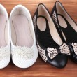 Two pairs female flat shoes on wooden background — Stock Photo #11803704