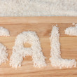Stock Photo: Sesalt on cutting board close-up