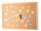 Keys with many question marks on cork board — Stock Photo