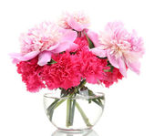 Bouquet of carnations and peonies in glass vase isolated on white — Stock Photo