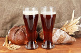 Two glasses of kvass with bread on canvas background close-up — Stock Photo