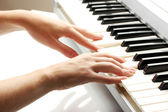 Hands of woman playing synthesizer — Stock Photo