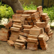 Heap of red bricks in yard - Stock Photo