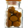 Jar with nutmeg isolated on white - Stockfoto
