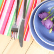 Tableware with flower on bright napkin close-up - Stock Photo