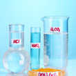 Test-tubes with various acids and chemicals on blue background - 图库照片