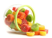 Colorful jelly candies in glass jar isolated on white — Stock Photo