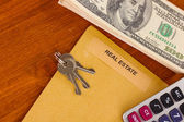 Folder with information of real estate on wooden background close-up — Stock Photo