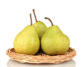 Ripe pears on a wicker mat isolated on white — Stock Photo