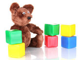 Sitting bear toy and color cubes isolated on white — Stockfoto