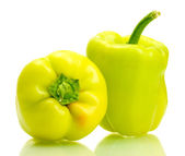 Fresh green bell peppers isolated on white — Stock Photo
