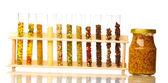 Diversas especiarias em tubos e frasco de mostarda isolado no branco — Fotografia Stock