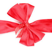 Red satin bow and ribbon isolated on white — Photo