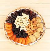 Different dried fruits on wooden background — Stock Photo