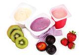 Fruit yogurts isolated on white — Stock Photo