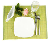 Table setting on a bamboo mat — Stock Photo