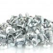 Chrome nuts and bolts on white background close-up — Stock Photo #11908912